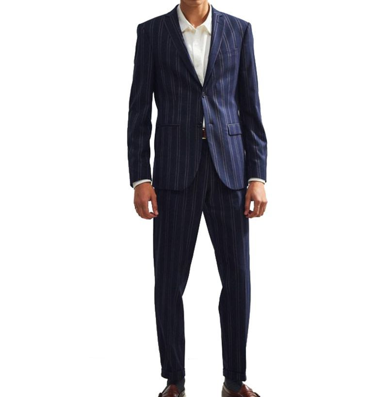 A Pinstripe Suit Doesn't Have to Be Stuffy. Here's How to Lighten It Up.