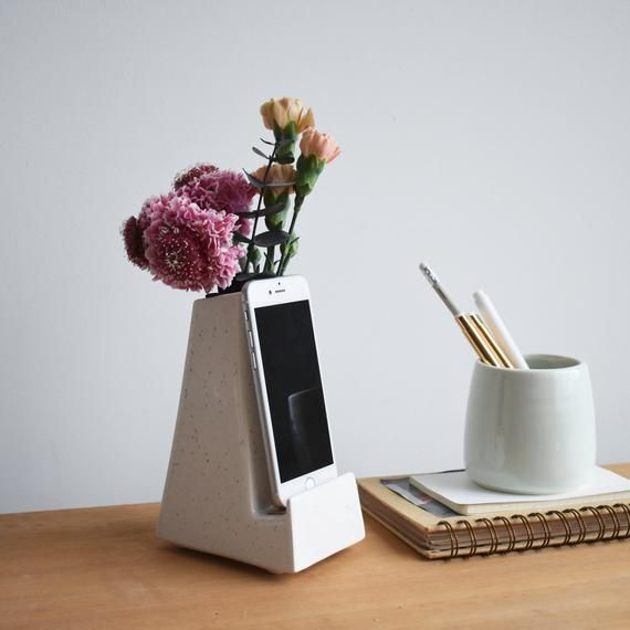Bloom Phone Vase STAKCERAMICS etsy.com $32.00 SHOP NOW If there's nothing your mom loves more than a quality FaceTime sesh, then she'll love this phone stand that doubles as a flower vase. It's sure to brighten up her office and her day.