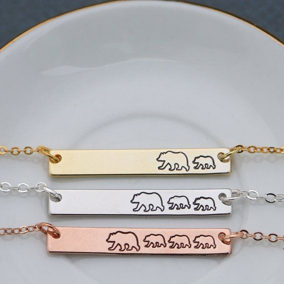 Mama Bear Necklace DistinctlyIvy etsy.com $22.09 SHOP NOW No one messes with mama bear, especially when she wears her status loud and proud. This minimalist style necklace is both feminine and bold.