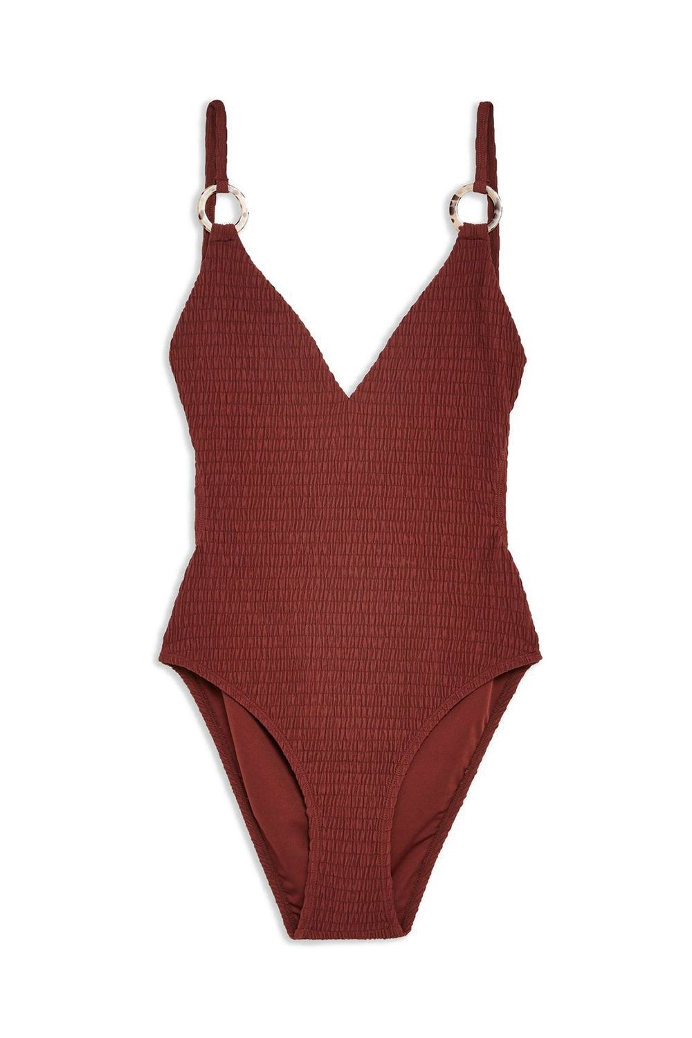 Best Shirred One-Piece Burgundy Shirred Ring Swimsuit Topshop topshop.com $52.00 SHOP IT This affordable swimsuit has cutouts all over and a ring detail on the straps for that not-too-simple look. You'll notice the one piece isn't completely smooth either because it's made with a shirred material.