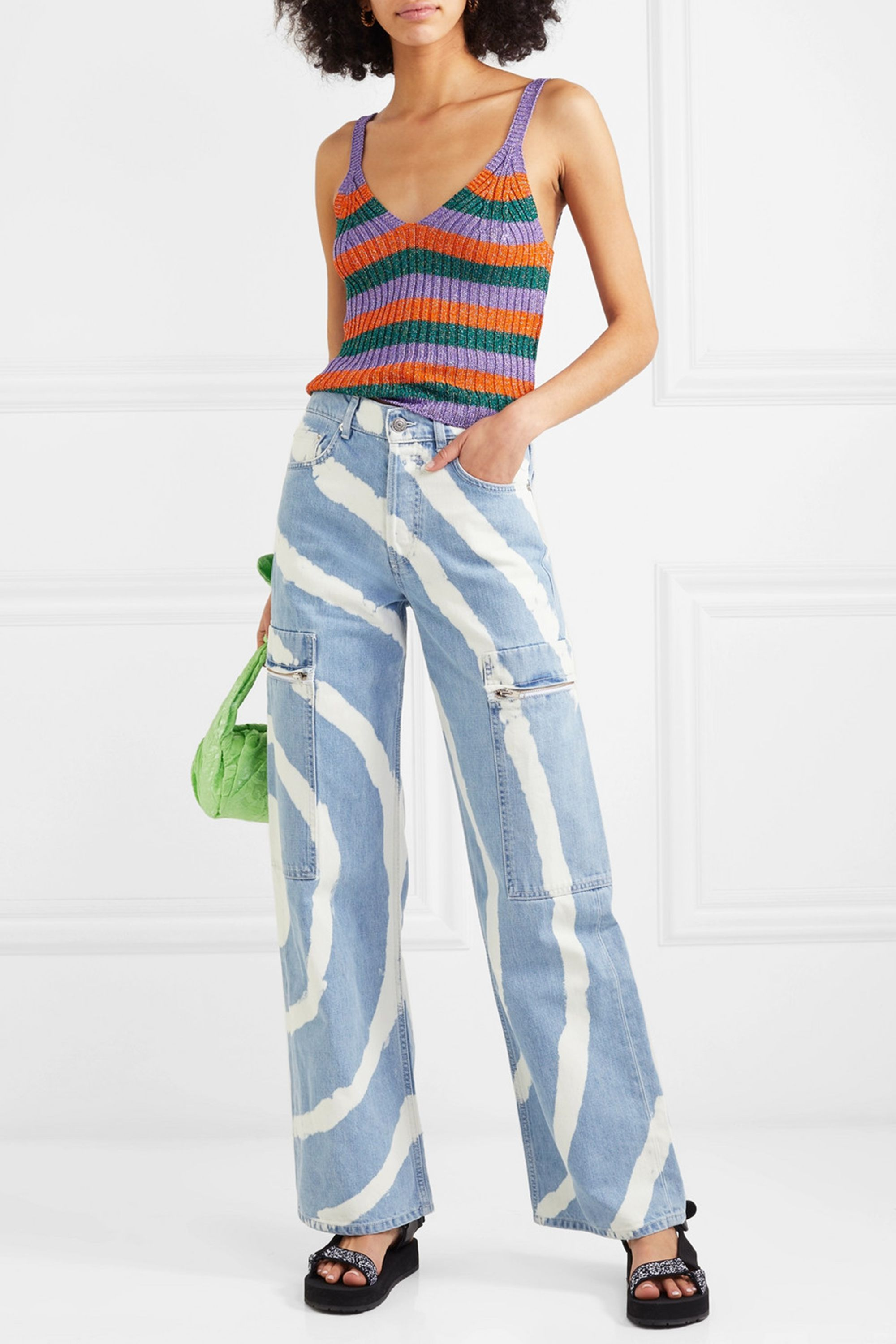 Blackstone Beached Jeans Ganni net-a-porter.com $415.00 SHOP NOW Tie dye is everywhere this season, but give it a shot in denim. Ganni's bleached jeans are perfect, and work well with fun summer trends like metallic knits, hiking sandals, and lime green bags.