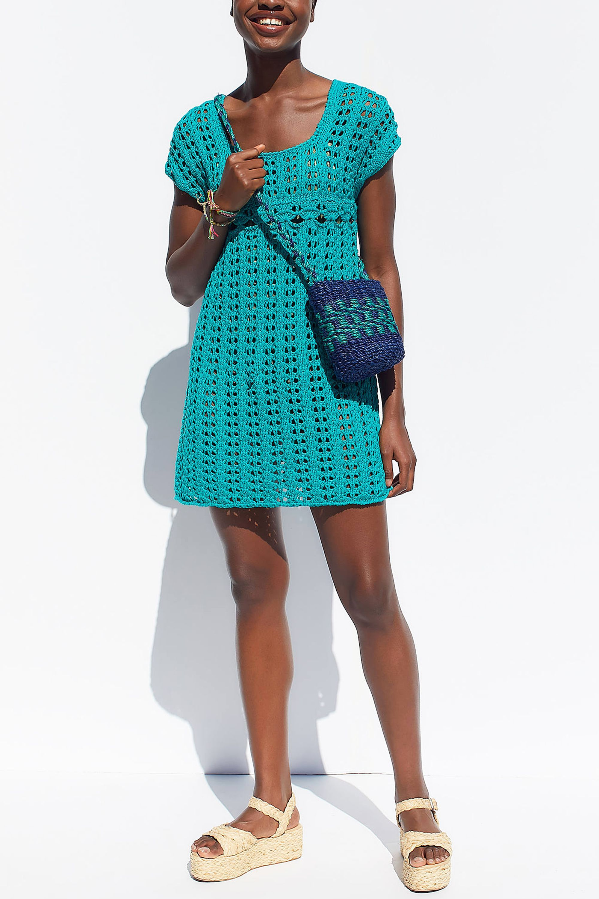 Peek-A-Boo Crochet Mini Dress Urban Outfitters urbanoutfitters.com $79.00 SHOP NOW A crochet mini dress is a super cute option for showing off your bathing suit, while not showing off too much skin. We love how this is styled with textured accessories, like a fun basket bag and woven wedges.