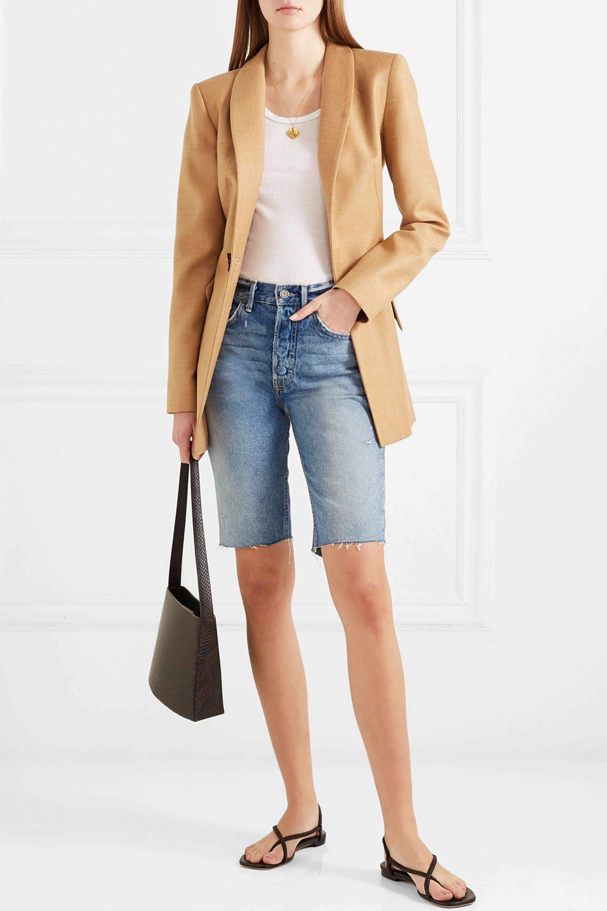 Beverly Frayed Denim Shorts GRLFRND net-a-porter.com $180.00 SHOP NOW This season swap out your daisy dukes for Bermuda shorts. These knee-length denim shorts work well with almost everything, but they look surprisingly chic with a camel-colored blazer and a ribbed tank.