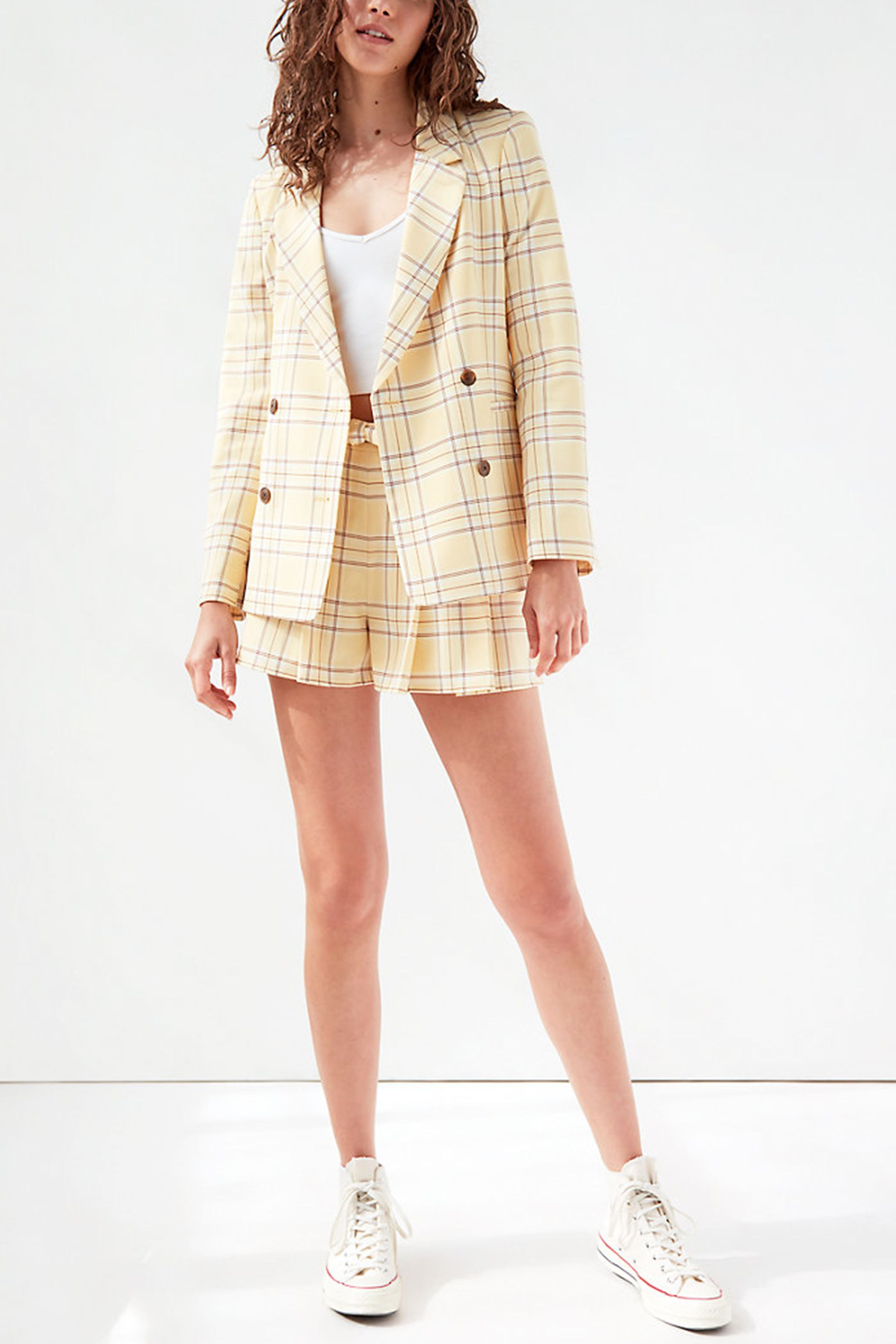 Checkered Double-Breasted Blazer Sunday Best aritzia.com $168.00 SHOP NOW Cher Horowitz' iconic yellow plaid suit will always tempt us, so we love this laid back rendition. Make the two-piece holiday ready with a white tank and Converses.