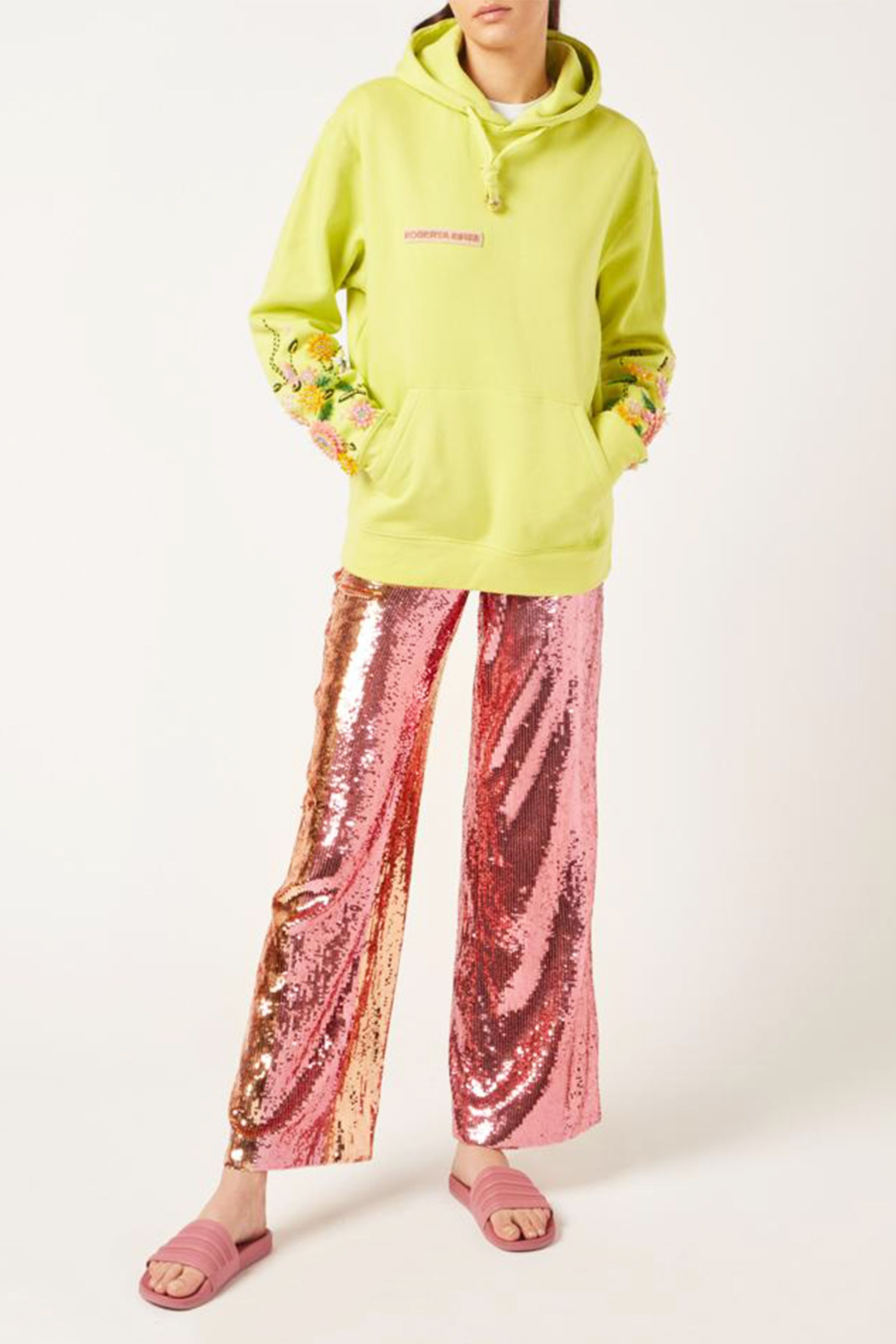 "Flower Garden Hoodie Roberta Einer koibird.com £515.00 SHOP NOW Sequin pants may not scream ""Memorial Day Weekend,"" but this fun color combo does. Clash metallic pink with a lime green hoodie and pool slides for an outfit everyone will compliment you on (or at the very least, notice)."
