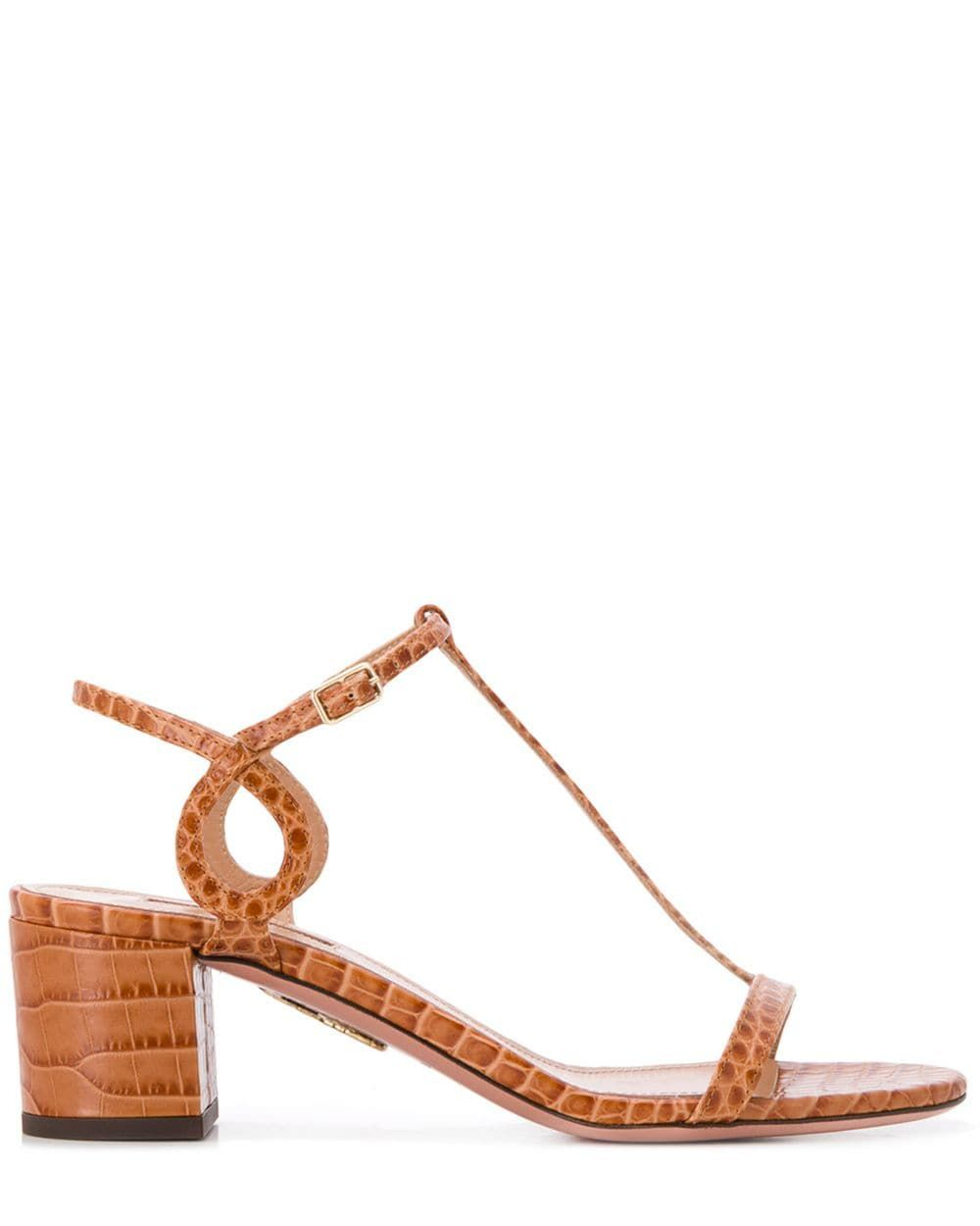 Block Heel Sandals Aquazzura farfetch.com $502.86 SHOP NOW The ultimate wear-everywhere heeled sandals, updated with swirly straps for a modern feel.