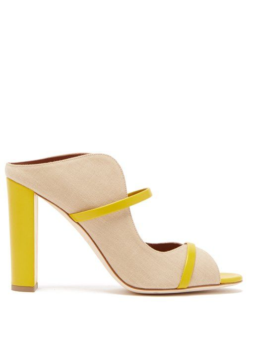 Norah Canvas and Leather Mules Malone Souliers matchesfashion.com $595.00 SHOP NOW A sturdy heel makes sky-high sandals feel much more supportive.