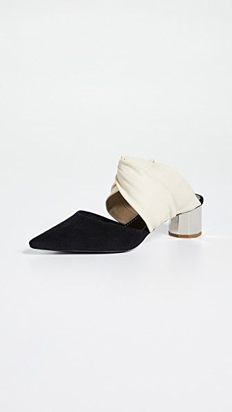 Pointed Toe Mules Proenza Schouler shopbop.com $640.00 SHOP NOW In graphic black and white, a sculpted low heel mule feels fresh and modern.