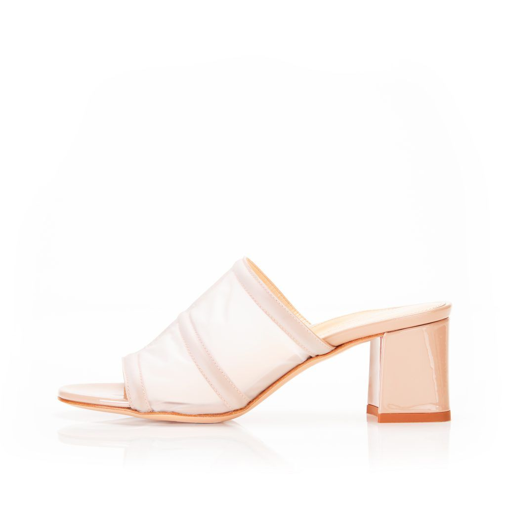 Bea Frost Vinyl Block Heel Slide Sandal Marion Parke marionparke.com $550.00 SHOP NOW This podiatrist-founded shoe line masterfully merges style and comfort.