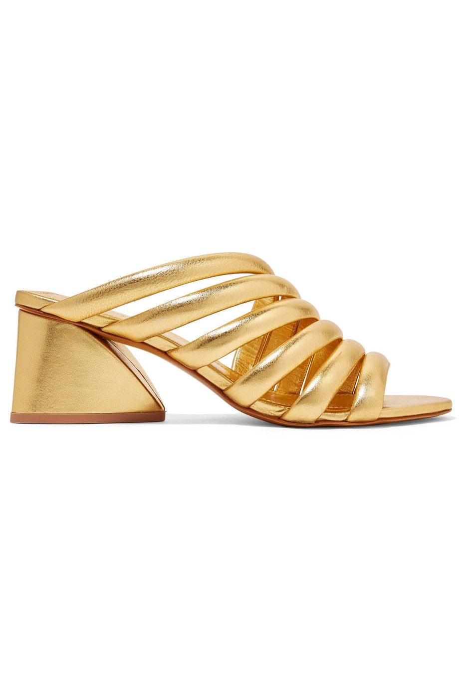 """Izzie Leather Mules Mercedes Castillo net-a-porter.com $210.00 SHOP NOW """"Summer work footwear is the hardest thing to find—you want to be naked as hell to battle those high temps, but you still have to dress it up enough to be proper (and get to those happy hours after hours). I plan to wrap my feet in gold so that nobody will notice I'm generally trying to wear as little as possible.""""— Estelle Tang, Senior Culture Editor"""