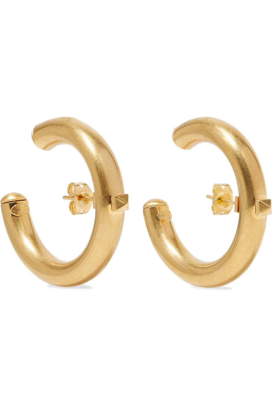 """Valentino Garavani The Rockstud Hoop Earrings Valentino net-a-porter.com $297.50 SHOP NOW """"Besides a By Far bag, I've added all of the earrings from Net-A-Porter's sale to my shopping cart. I tend to rely on accessories during summer office hours, because I can't add anything that adds...sweat to my outfit. Thus, jewelry and bags. This Valentino pair is something I could easily wear on the daily, but the centered post makes them way more interesting than your average hoops.""""— Justine Carreon, Market Editor"""