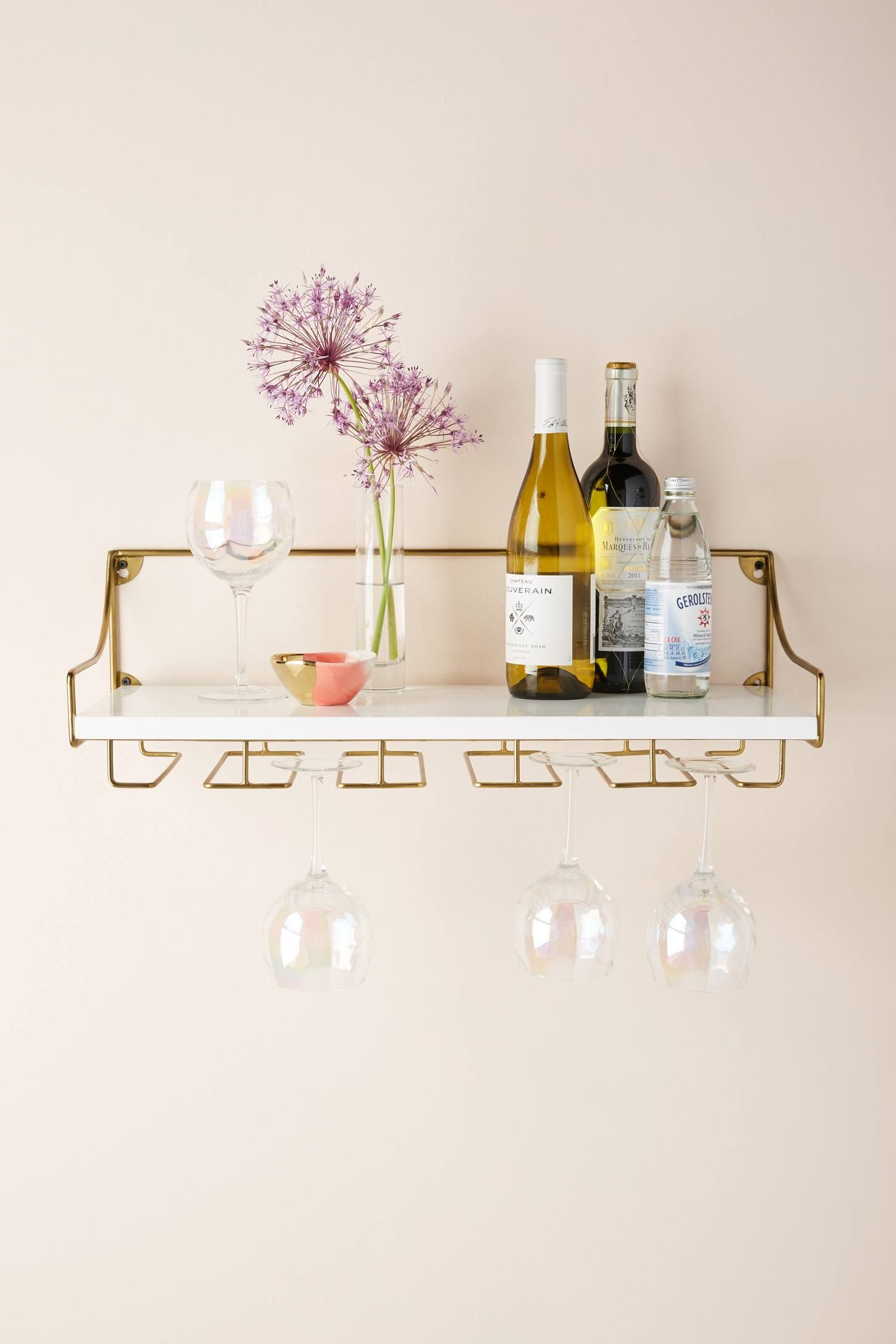 Anthropologie S Wall Mounted Wine Glass Shelf Is Essentially A Space Saving Bar Cart