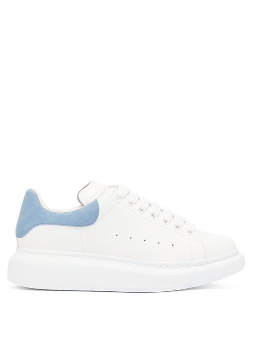 Raised-Sole Low-Top Leather Trainers Alexander McQueen matchesfashion.com $490.00 SHOP NOW With pumped up soles, these exaggerated sneakers are the comfortable alternative to heels with suits.