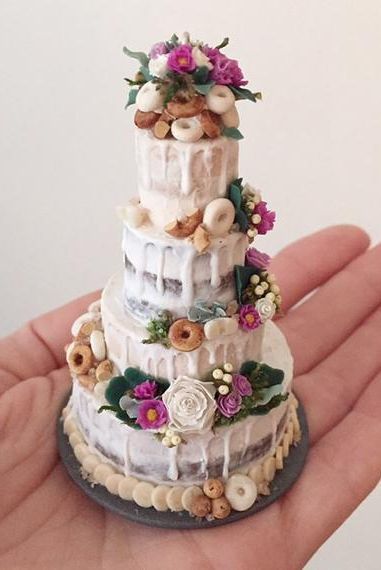 Miniature replica of wedding cake. Finding the perfect gift for newlyweds