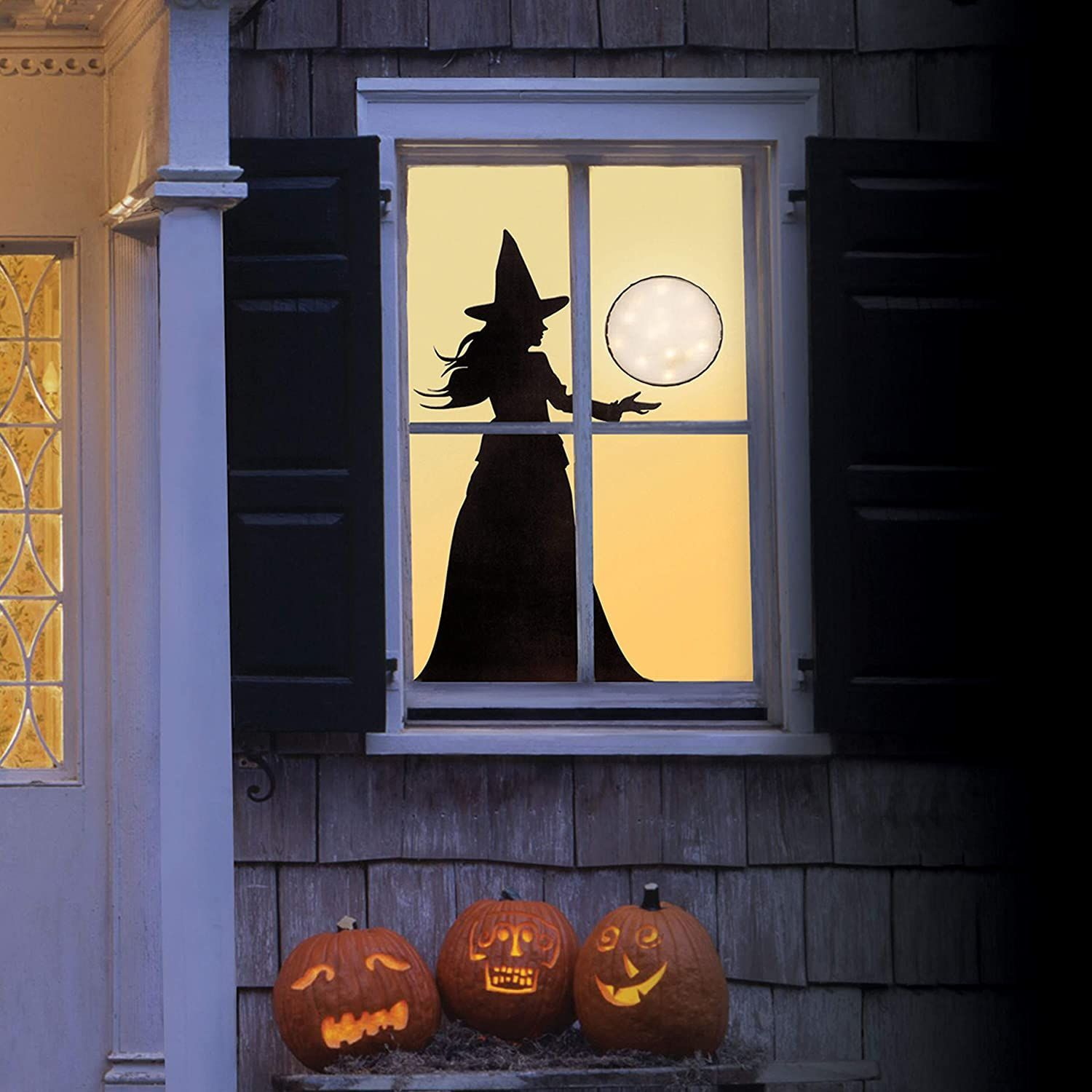 35 Ideas To Decorate Windows With Silhouettes On Halloween Shelterness
