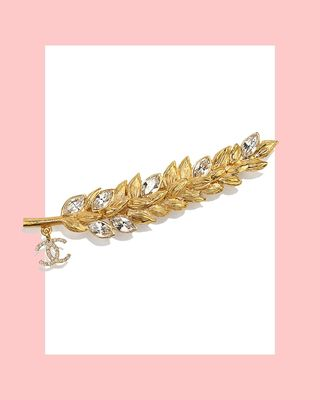 Broche en or et cristal en métal et strass