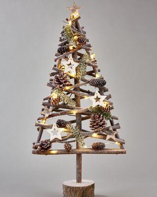 Effet bois lumineux, sapin de Noël sur la table