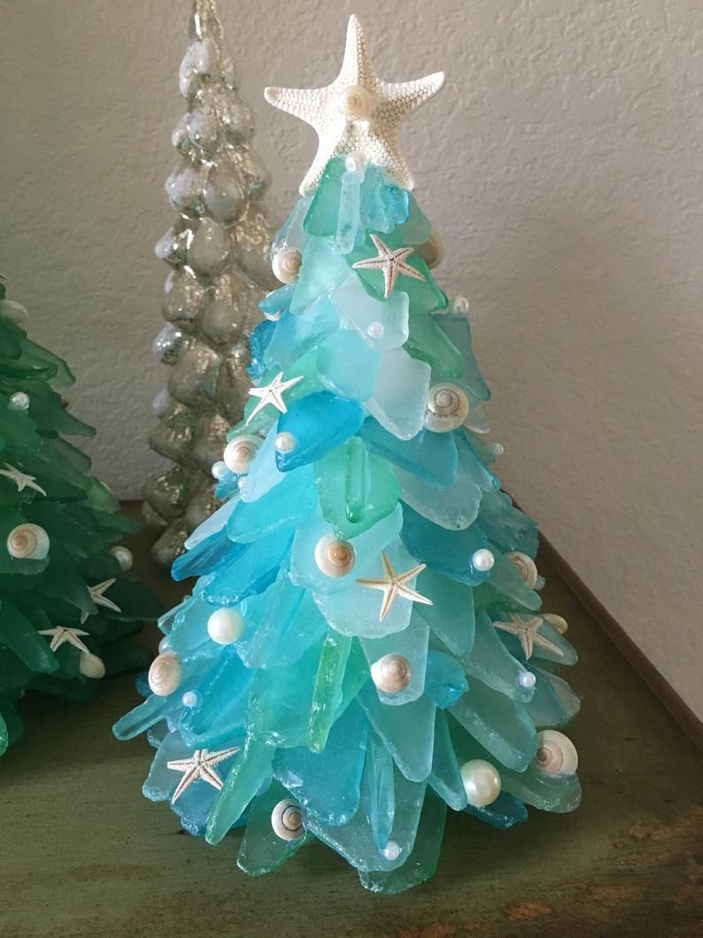 Ocean Themed Christmas Tree Decorations  from hips.hearstapps.com