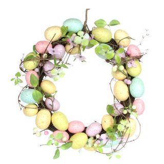 Fleur de printemps et couronne d'oeufs de Pâques pastel