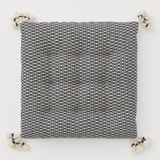 Tasselled seat cushion