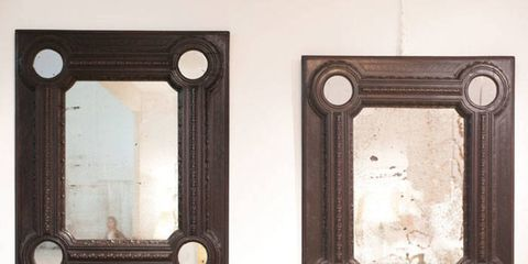 "<p>""Bold, strong, and simple, they look like they're from 17<sup>th</sup>-century Florence, but they're actually modern."" Discovered in a palace in Naples, the pair of circa 1930 Italian mirrors with beautifully weathered original glass sit in black patinated wood frames. With Anne Autegarden 17th Century Decorative Arts, Brussels.</p>"