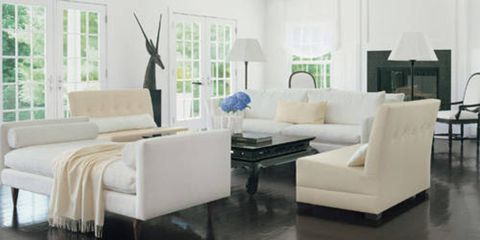 Benjamin Noriega-Ortiz designed loveseats in Gulf Fabrics faux leather. Back-to-back Room & Board sofas and daybed in microfiber. Ralph Lauren Home table. Drexel Heritage chairs. Gretchen Bellinger fabrics on pillows. Wisteria lamps. Royale draperies.