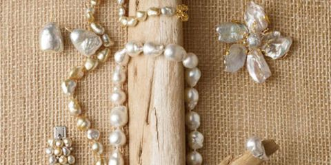 "<p>Like all natural pearls, Keshis, or ""chance"" pearls, are all nacre, iridescent layers of mother-of-pearl.</p>   <p><h2>Clockwise from Top Left:</h2> <a href=""http://www.stephenrussell.com/"" target=""_blank"">Stephen Russell</a>'s baroque pearl earrings in 18k gold. <a href=""http://www.chanel.com/"" target=""_blank"">Chanel</a>'s keshi pearl necklace with Camelia clasp in 18k gold. <a href=""http://russelltrusso.com/"" target=""_blank"">Russell Trusso</a>'s freshwater keshi, 18mm baroque South Sea pearl and diamond Magnolia Blossom brooch/pendant. Baroque South Sea pearl and diamond ring from <a href=""http://www.kathleendughi.com/"" target=""_blank"">Kathleen Dughi Jewelery</a>. Freshwater keshi pearl and diamond earrings from <a href=""http://www.cellinijewelers.com/"" target=""_blank"">Cellini</a>. Australian South Sea keshi pearl bracelet with diamonds by Utopia. <p><h2>Center:</h2></p> Baroque South Sea cultured pearl Double Wrap necklace with 18k Coral/Bamboo clasp by <a href=""http://www.mishnewyork.com/"" target=""_blank"">Mish New York</a>."
