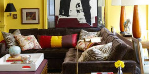 "<p>Don't be shy, paint over all of it. ""This was a peachy-toned oak 'family room' that read more like a second-tier hotel lobby,"" designer <a href=""http://www.nickolsenstyle.com/"" target=""_blank"">Nick Olsen</a> says. ""I convinced the owners to paint over all of it — walls, wainscoting, beams, <em>and</em> fireplace mantel — in this taxicab yellow. It instantly became the warmest room in the apartment!""</p>"