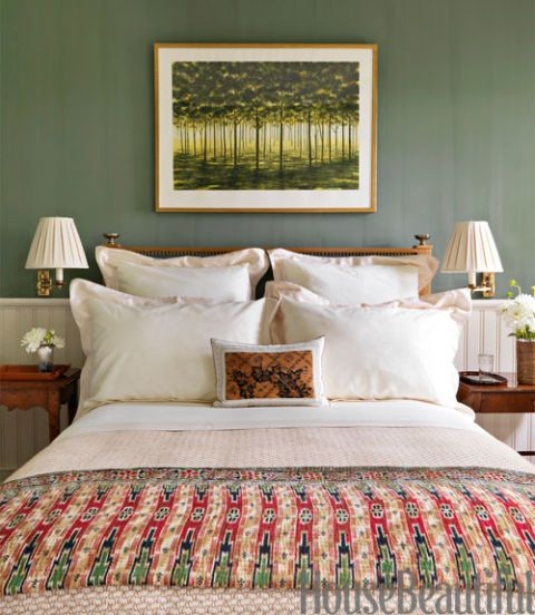"<p>An April Gornik painting is set off by walls in Tavern Green by <a href=""http://www.milkpaint.com/"" target=""_blank"">The Old-Fashioned Milk Paint Co.</a> in a bedroom of this East Hampton home by designer Bunny Williams. An Indonesian quilt adds texture ""and a Deco feeling.""</p>"