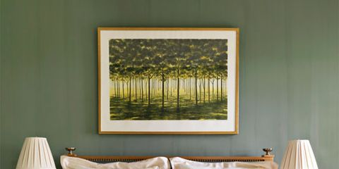 """<p>An April Gornik painting is set off by walls in Tavern Green by <a href=""""http://www.milkpaint.com/"""" target=""""_blank"""">The Old-Fashioned Milk Paint Co.</a> in a bedroom of this East Hampton home by designer Bunny Williams. An Indonesian quilt adds texture """"and a Deco feeling.""""</p>"""