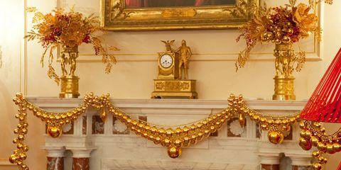 Interior design, Interior design, Brass, Artifact, Molding, Flower Arranging, Picture frame, Religious item, Tradition, Vase,