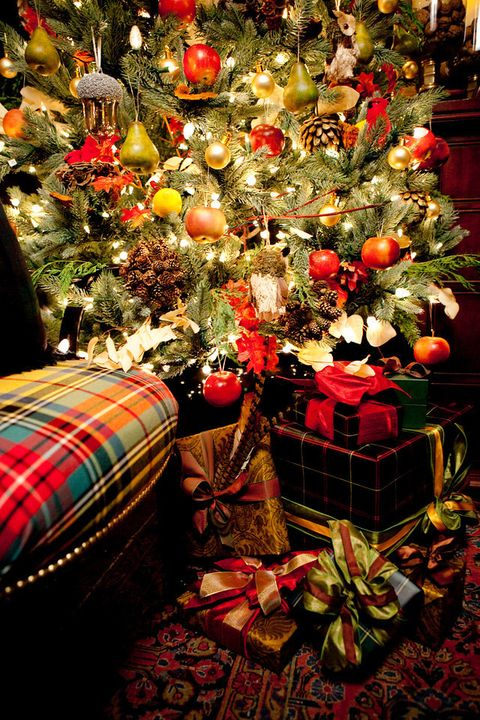 "<p>""I have several tricks that I use each year when the gift-wrapping tasks come along. First, I order wallpaper &mdash; more expensive, but, there are amazing pattern options &mdash; that I use for my wrapping paper. The wallpaper is a much stronger weight than regular wrapping paper, so there's never any issues with the paper tearing. Second, I love layering ornaments or feathers and antlers on the bows as an extra decoration, sometimes I even double the amount of ribbons."" &mdash;<a href=""http://smwdesign.com/"" target=""_blank""><em>Scot Meacham Wood</em></a></p>"