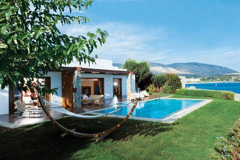 Property, Swimming pool, Real estate, Resort, Azure, Villa, Composite material, Home, Shade, Yard,