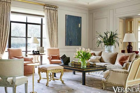 Sofa in a Pierre Frey fabric, Cameron Collection; armchairs, Gregorius Pineo; stool in a Vervain fabric, Dennis & Leen; coffee table, Erika Brunson; tables, Dessin Fournir; curtains in a Fortuny fabric; walls in Pink Ground, Farrow & Ball; art, John Pavlicek.