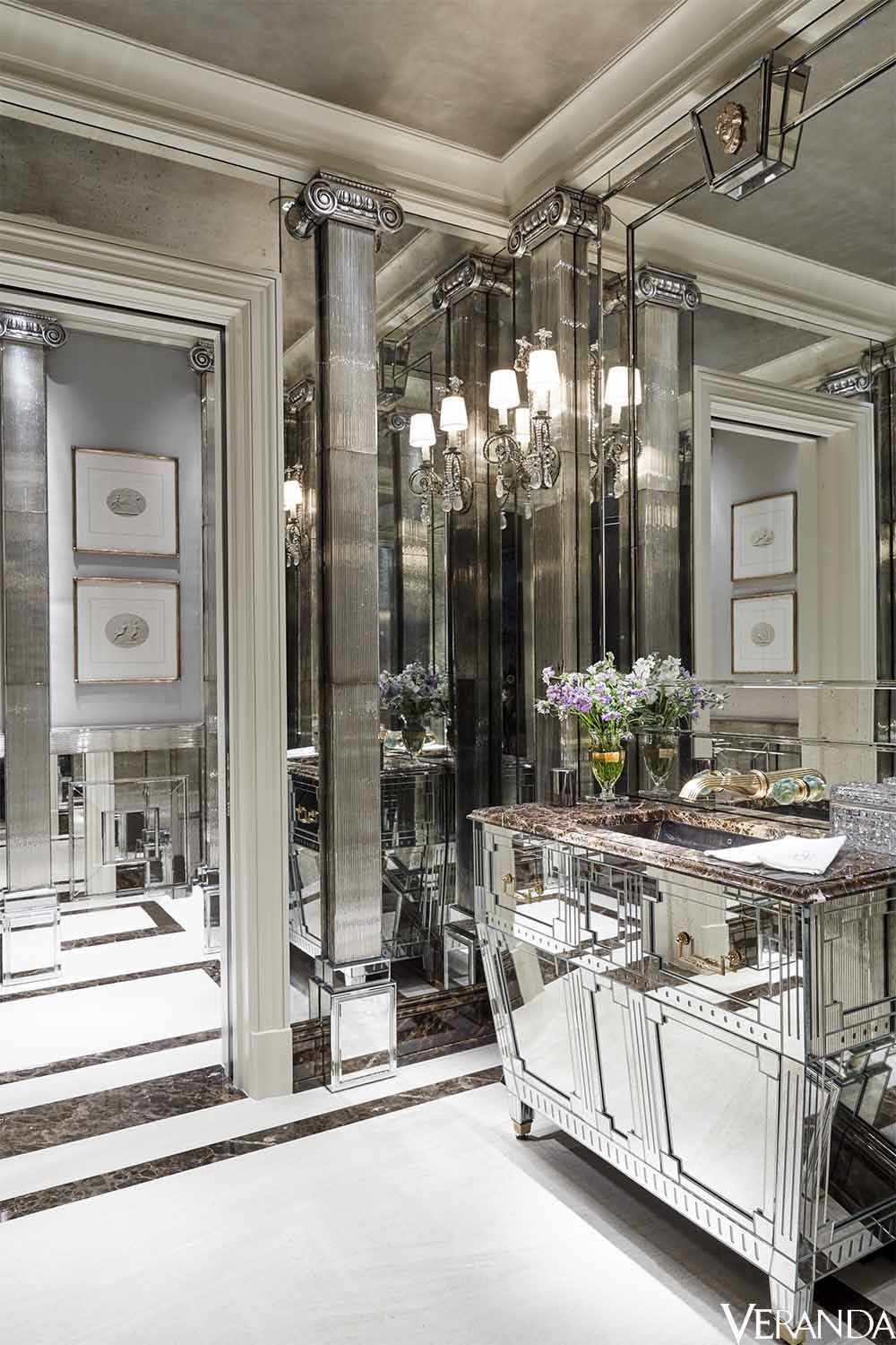 Custom-made mirrored surfaces transform a powder room into a glittering space. Cabinet and mirrors, John Himmel Decorative Arts; sink and fittings, Daum for THG; sconces, Niermann Weeks.
