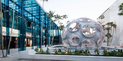 Commercial building, Arecales, Urban design, Palm tree, Circle, Headquarters, Sphere,