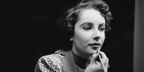 <p>Touching up her lipstick in November of 1948.</p>
