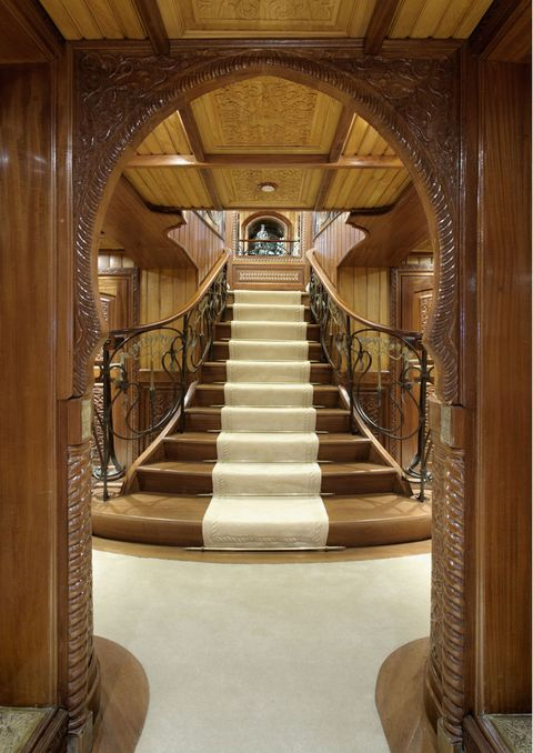 Stairs, Brown, Interior design, Ceiling, Handrail, Hardwood, Light fixture, Wood stain, Symmetry, Building material,