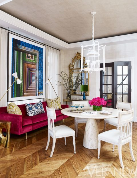 <p>In the dining room, European antiques mingle effortlessly with shapely modernist pieces. Gustavian chairs in a Jasper leather; vintage Edward Wormley for Dunbar sofa in a Lelievre velvet; chandelier, Stephen Antonson; wallcovering, Holland & Sherry; photograph, Robert Polidori.</p>