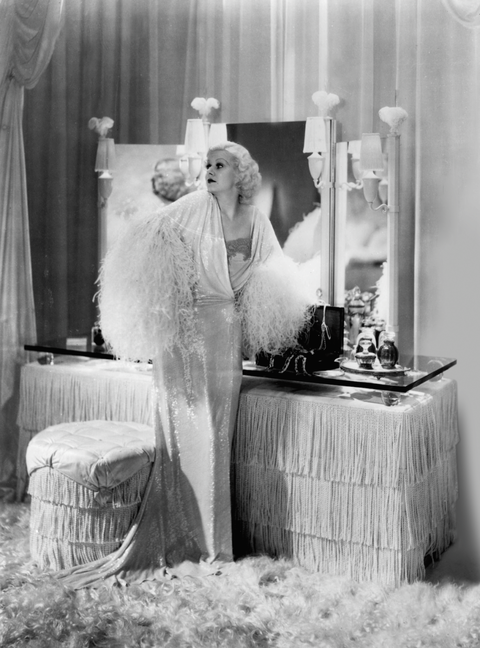 <p>The Manhattan bedroom featured in this Depression-era comedy of errors—which stars Jean Harlow, among many others—is an Art Deco confection, with miles of white satin and tassel fringe, ostrich feather finials, and plenty of gleaming glass and mirrors. The 1933 farce was based on a play by George S. Kaufman and Edna Ferber, and directed by George Cukor.</p>
