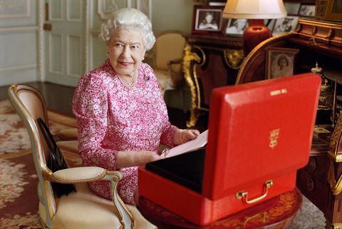 LONDON, UNITED KINGDOM - JULY 2015: (This image is free of charge for a month from release. Use or reproduction in any format on any platform after October 8, 2015, must be approved first by Royal Communications at Buckingham Palace.) In this handout photo released by Buckingham Palace on September 8, 2015, Queen Elizabeth II is seated at her desk in her private audience room at Buckingham Palace with one of her official red boxes which she has received almost every day of her reign and contain important papers from government ministers in the United Kingdom and her Realms and from her representatives across the Commonwealth and beyond. The photo has been taken by Mary McCartney in July 2015, to mark the moment she becomes the longest reigning British Monarch.