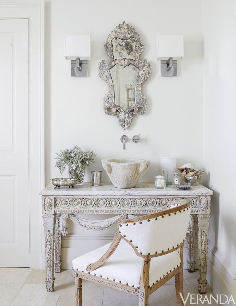 Louis XVI console, Tara Shaw Antiques; sink fittings, Grohe; sconces, Restoration Hardware; 18th-century Swedish armchair in a Libeco linen; floor tiles, Walker Zanger.