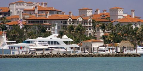 Coastal and oceanic landforms, Building, House, Residential area, Watercraft, Home, Roof, Luxury yacht, Marina, Mixed-use,