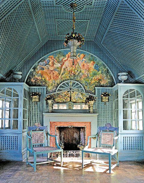 Interior design, Hearth, Fireplace, Light fixture, Living room, Arch, Paint, Fire screen, Symmetry, Temple,