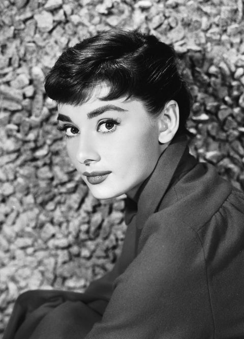 Portrait of Belgian-born American actress Audrey Hepburn (1929 - 1993) as she sits by a stone wall, early 1950s. (Photo by Hulton Archive/Getty Images)