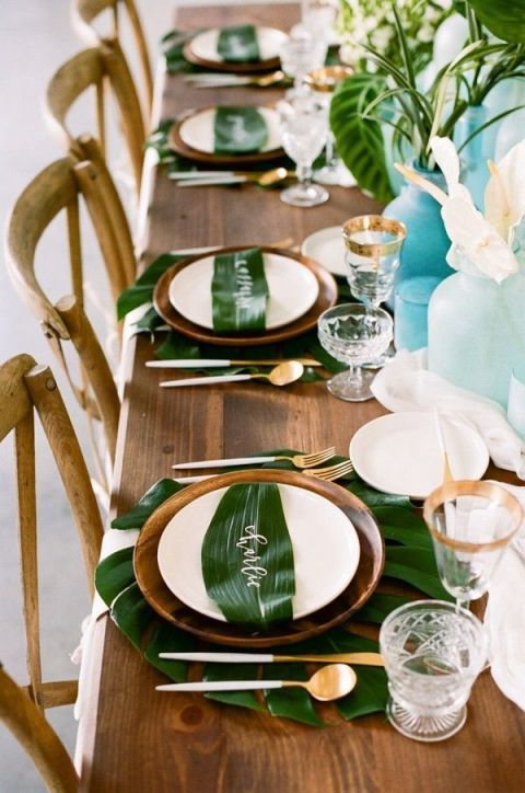 "<p>What says summer more than tropical leaves and sea glass?</p><p>Via <a href=""http://ruffledblog.com/galleries/tropical-leaves-and-sea-glass-wedding-shoot/ruffled-photo-by-httpkristamason-com-httpruffledblog-comtropical-leaves-and-sea-glass-wedding-shoot-37/"" target=""_blank"">Ruffled Blog</a></p>"
