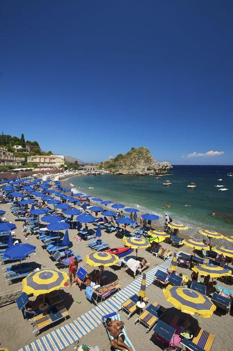 Body of water, Coastal and oceanic landforms, Tourism, Coast, Ocean, Vacation, Azure, Sea, Umbrella, Travel,