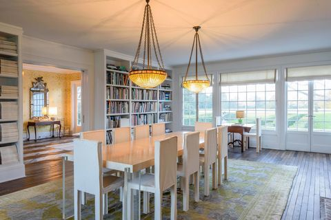 Room, Dining room, Ceiling, Property, Interior design, Furniture, Building, Lighting, Chandelier, Yellow,