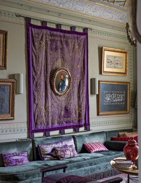 Interior design, Room, Purple, Wall, Interior design, Living room, Magenta, Couch, Picture frame, Violet,