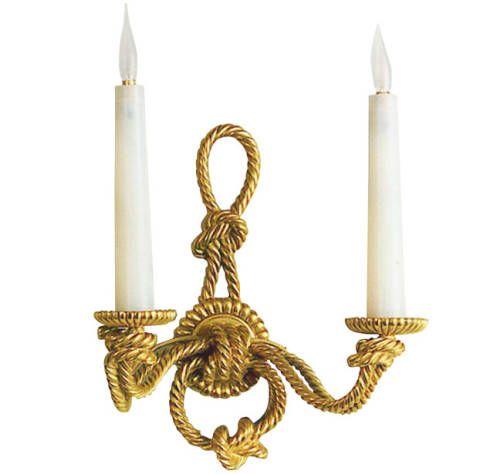 Brass, Metal, Bronze, Symbol, Bronze, Iron, Gold, Natural material, Religious item, Building material,